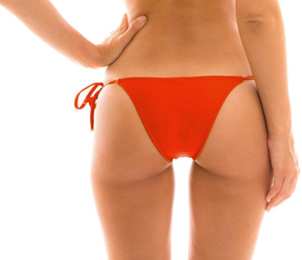 Rote brasilianische Bikinihose mit Seitenschnüren